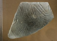 Fragment of a decorated stone bowl from Göbekli Tepe (Photo. Schmidt, Copyright DAI).