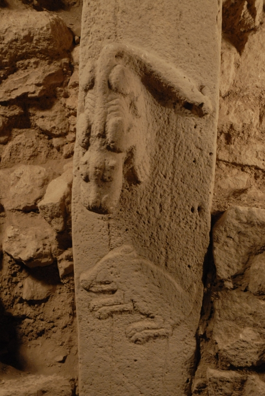 Pillar 27 in Enclosure C, detail of predator in high relief and boar in low relief (Photo D. Johannes, copyright DAI).
