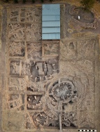Aerial of the so-called main excavation area of Göbekli Tepe, the older monumental enclosures in the lower center. (Photo: E. Kücük, DAI)