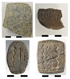 Collection of plaquettes bearing iconographic symbolism from Göbekli Tepe. (Photo: N. Becker, DAI)